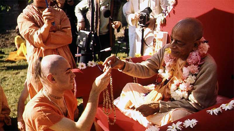 Hare Krishna devotee bowing to a false master