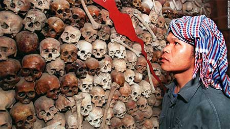 A Cambodian looking at a collection of skulls that make up a map of Cambodia, at Tuol Sleng Prison Museum in 1998. Pic: source.