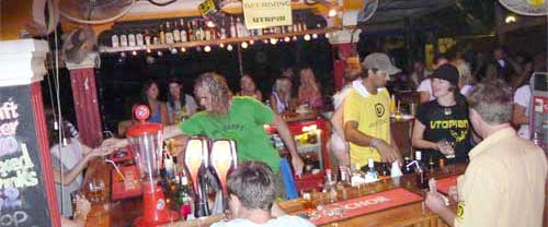 Backpackers tending bar @ Utopia