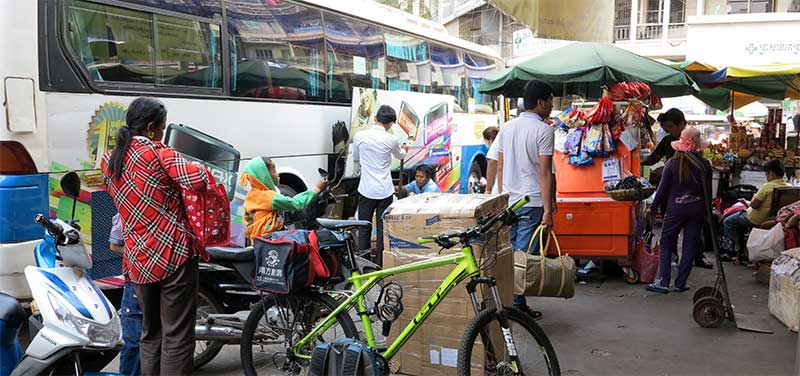 Loading the Capitol Tours bus to Sihanoukville from their private terminal; $3 extra to bring your bike.