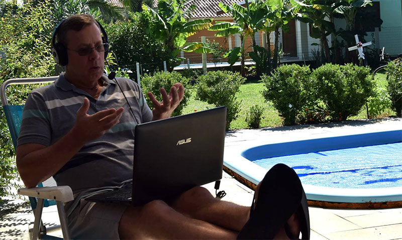 Teaching English online by the pool in Asia